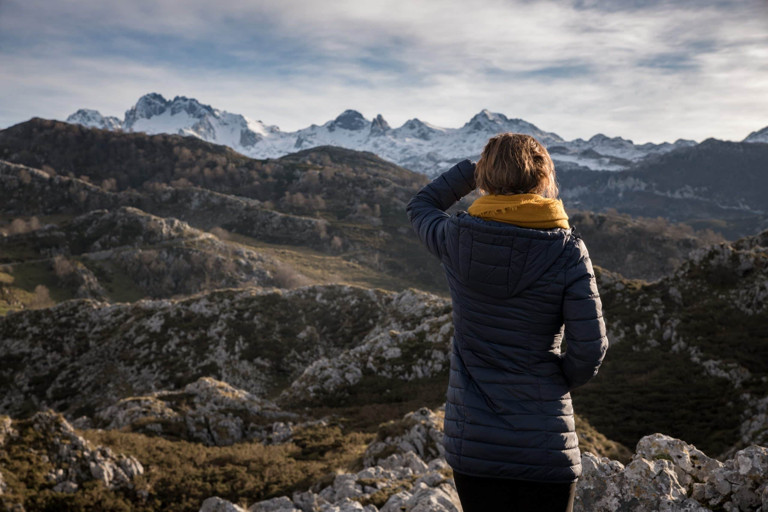 Photo of creative community leader Judith Aldama looking at the distant Cantabrian Mountains of Spain.