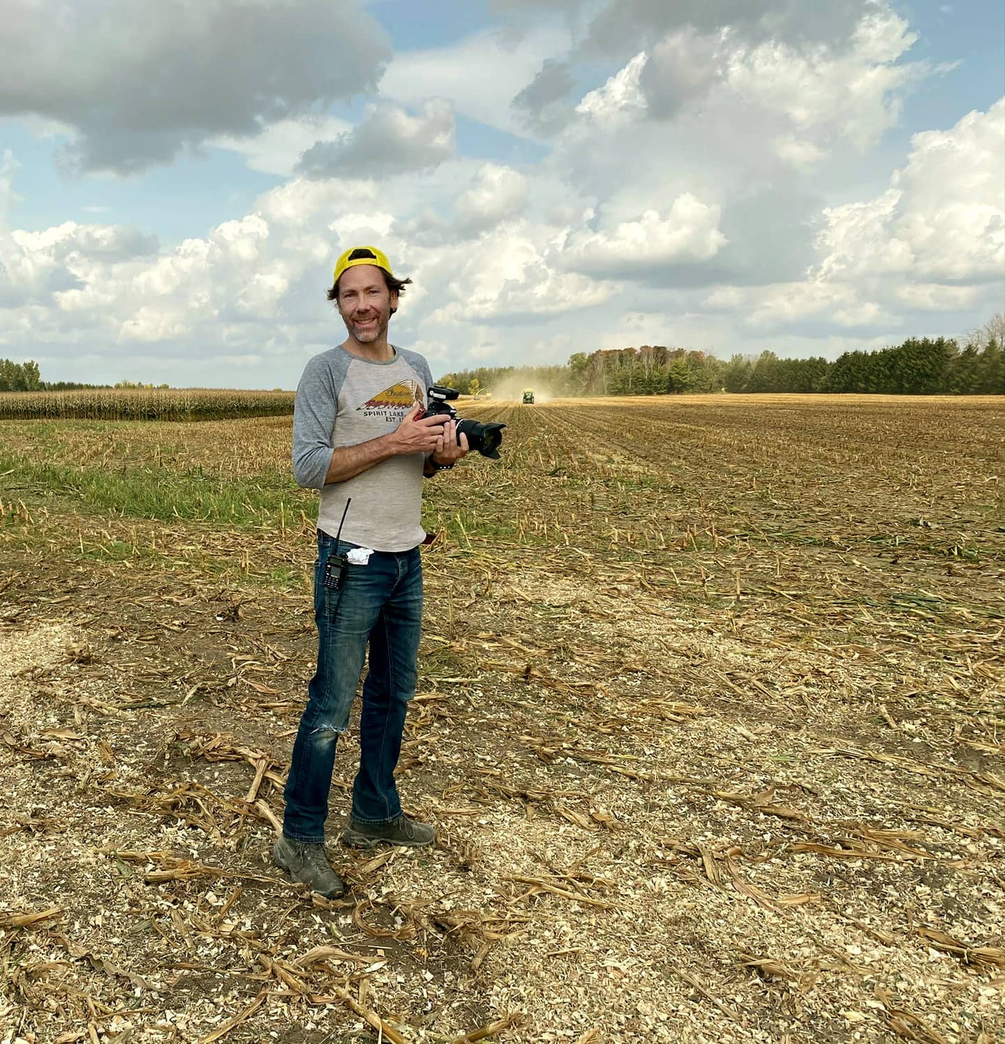 Photo of creative community member, Brett Gilmour, physically distancing in an Ontario dairy cornfield during a John Deere photo shoot.