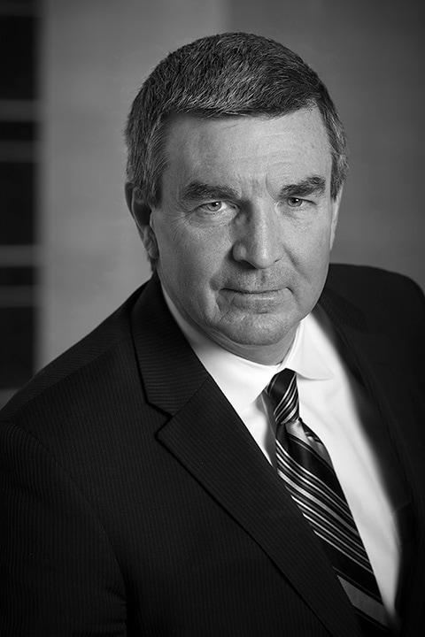 Black and white headshot of David Reid in Calgary by portrait photographer Brett Gilmour