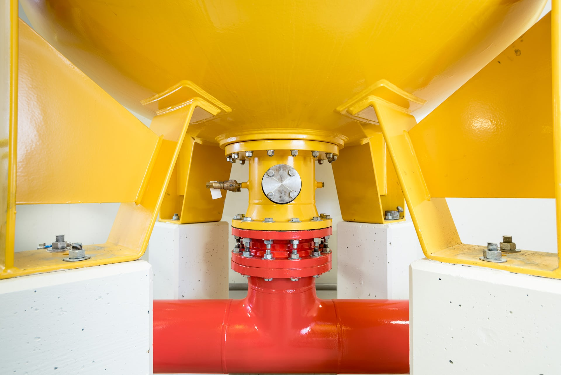 Industrial photography of a yellow and red vessel at a water treatment plant in Vancouver, British Columbia. Photographed during branding projects for Maple Reinders.