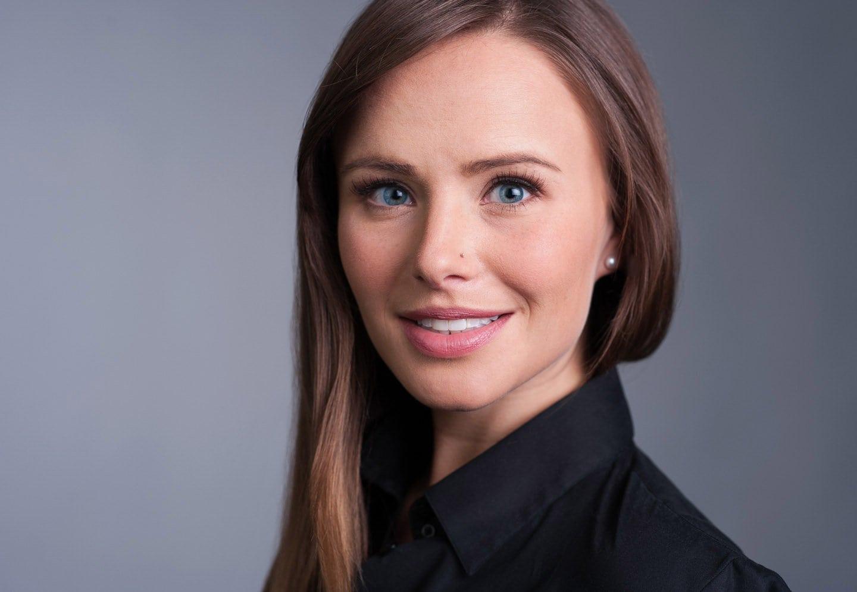 Business portrait headshot of a young Caucasian woman