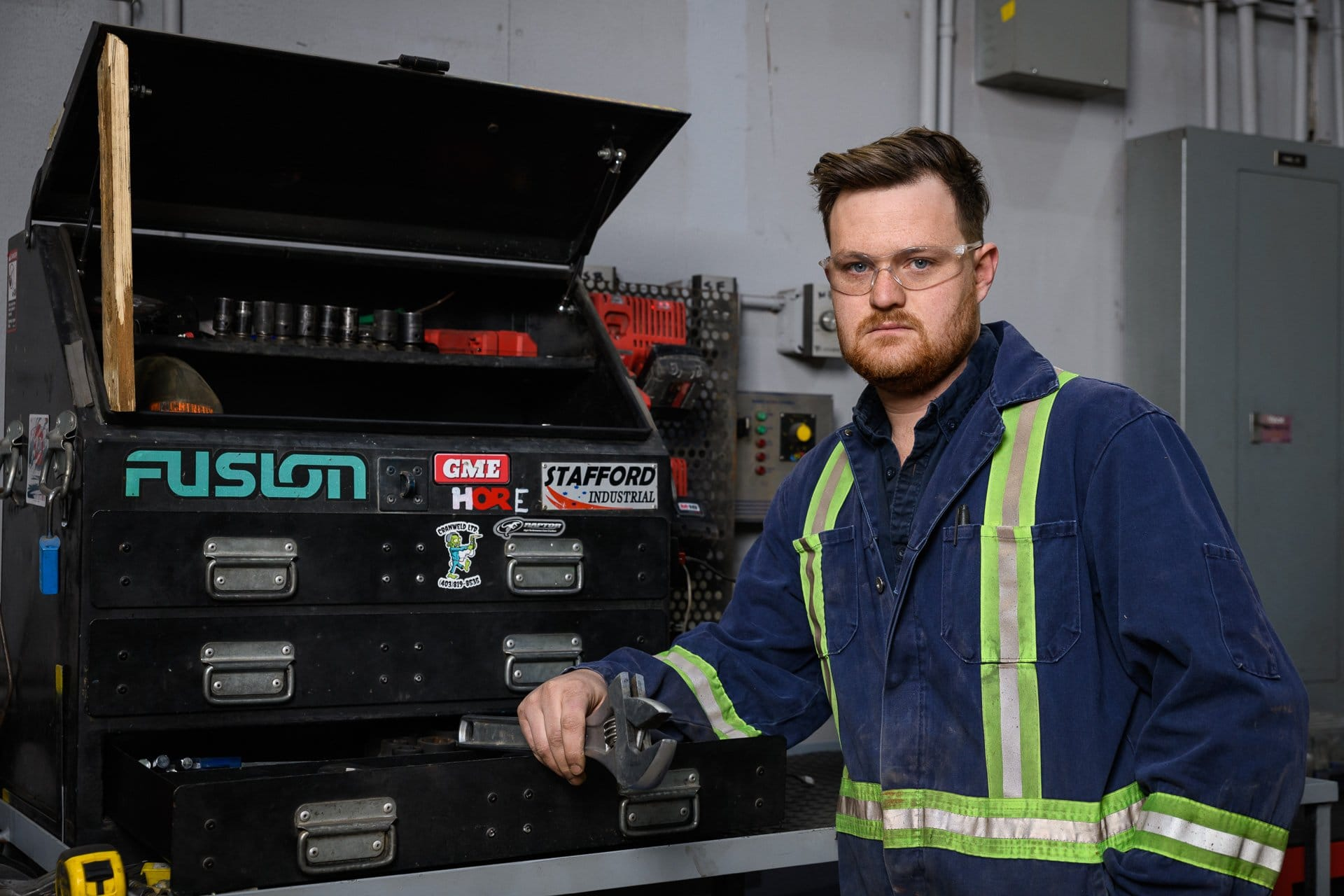 branding photography of a man and his tool box at a manufacturing plant in Calgary, Alberta by corporate branding photographer Brett Gilmour